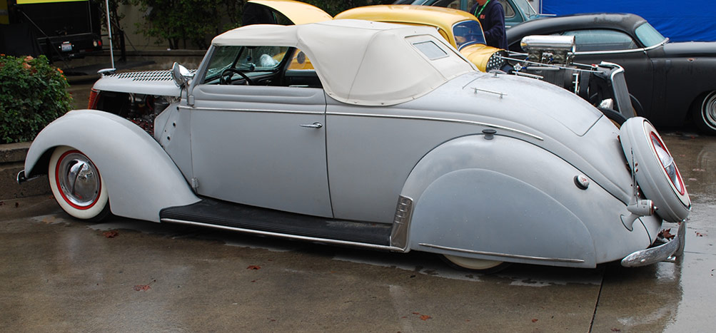 1937 ford customs custom car chroniclecustom car chronicle 1937 Ford Wiper Motor lowered chopped windshield with chopped folding top skirts white walls with single bar hubcaps custom side trim and rock shield on